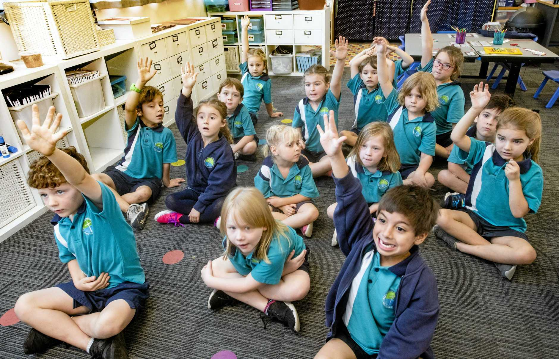 Kindergarten students answer a question in class at the Clarence's fastest growing school, Pacific Valley Christian School.