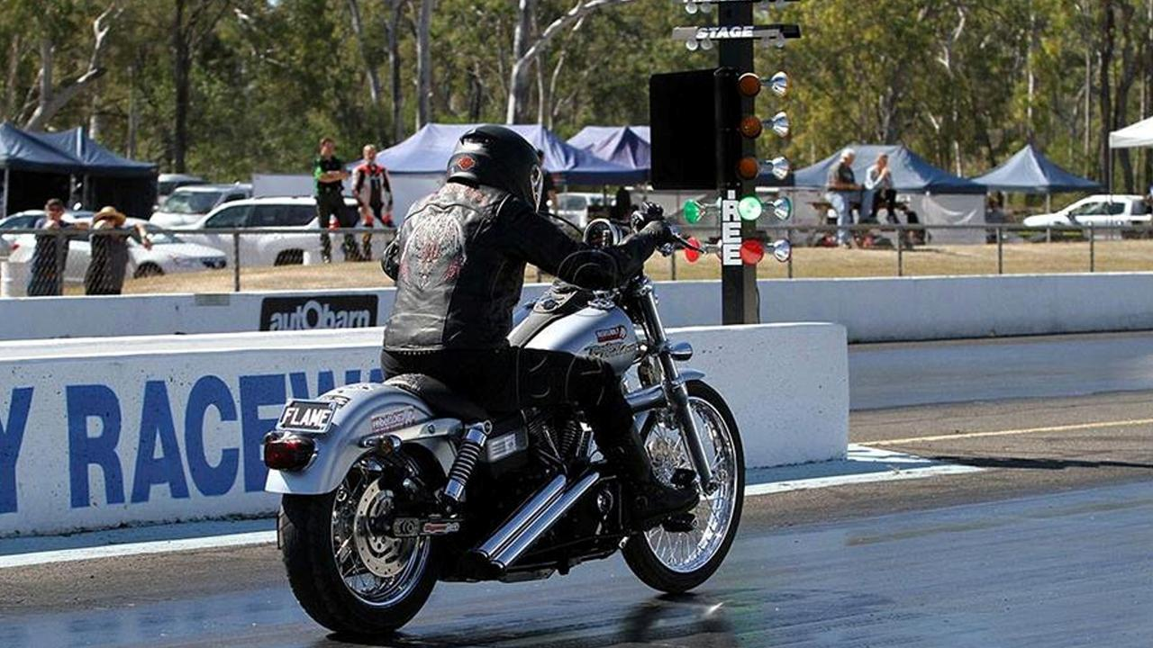 Flame Howard performs either on the Harley or with her band Flame Classic Rock Band