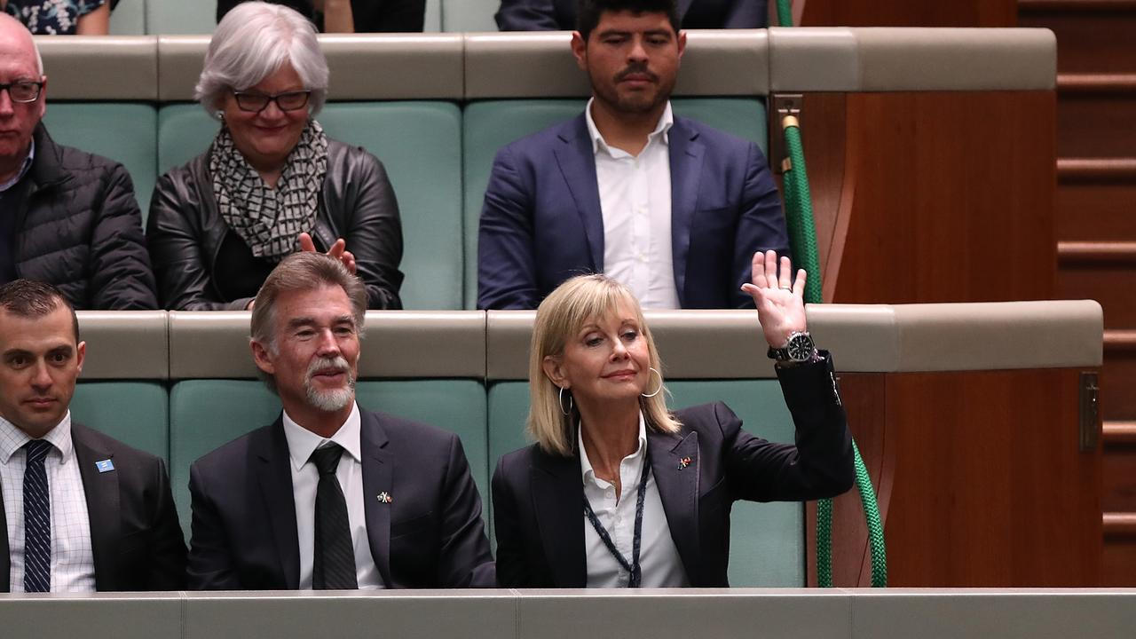 Olivia Newton-John waves to the Prime Minister. Picture Kym Smith