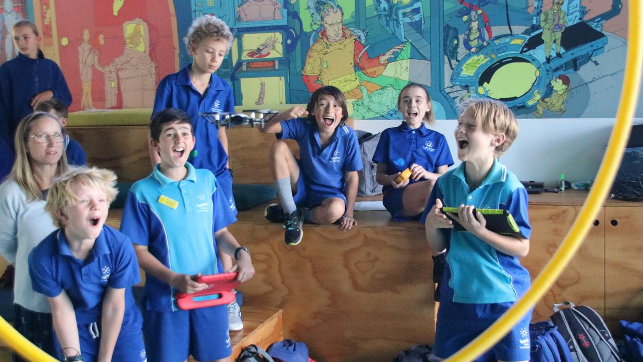 Sunshine Beach State School's Young Inventors are amazed at the power of the drone.