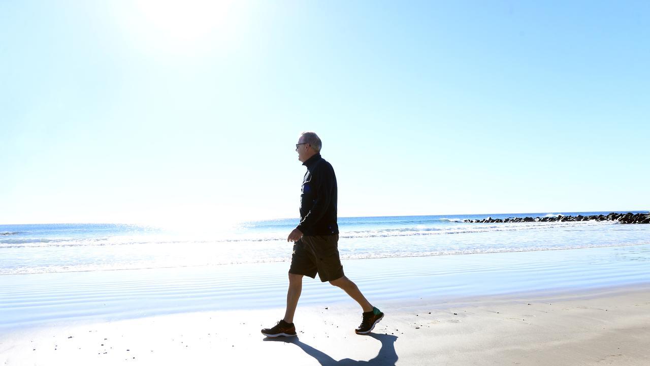 MORNING WALK: Bruce Worthington enjoying the beautiful weather at Bargara Beach.