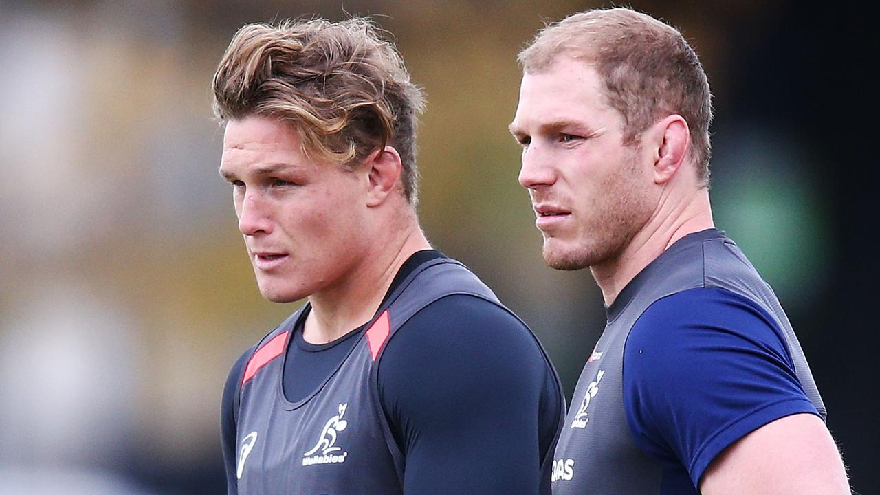 Michael Hooper talks to David Pocock of the Wallabies during a training session.