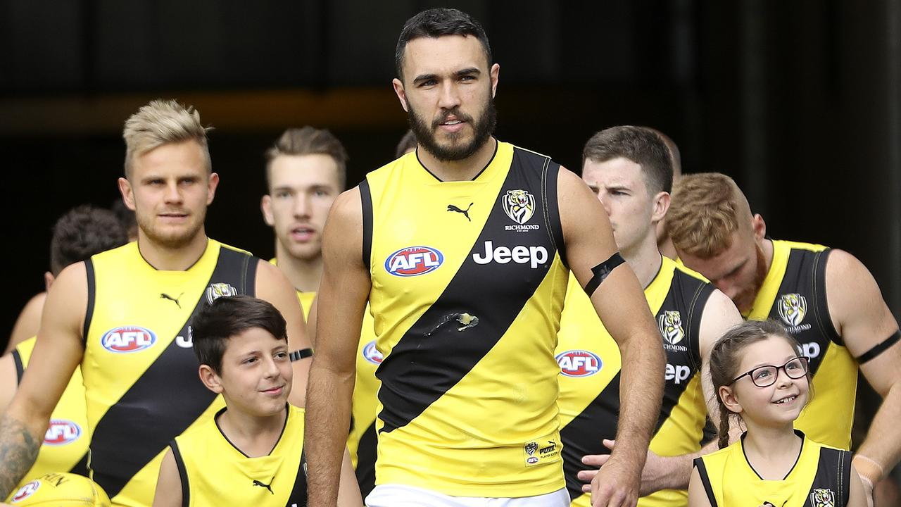 Shane Edwards leads the Tigers out against Port Adelaide. Picture: Sarah Reed