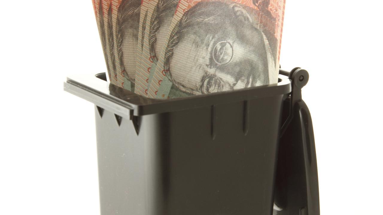 Concept for Trash and Treasure. Australian twenty dollar notes in the wheelie bin.