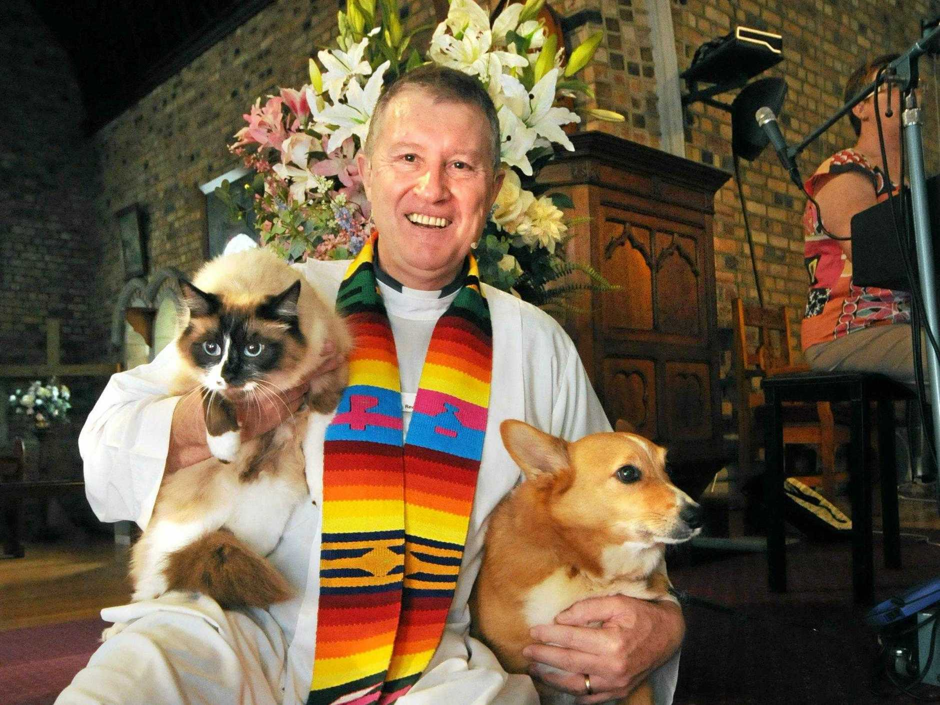 PAMPERING TO PETS: The Rev Alan Shaw with Poppy the rag doll cat and Roger the corgi at a previous Blessing of the Pets service at St Andrew's Anglican Church in Lismore.