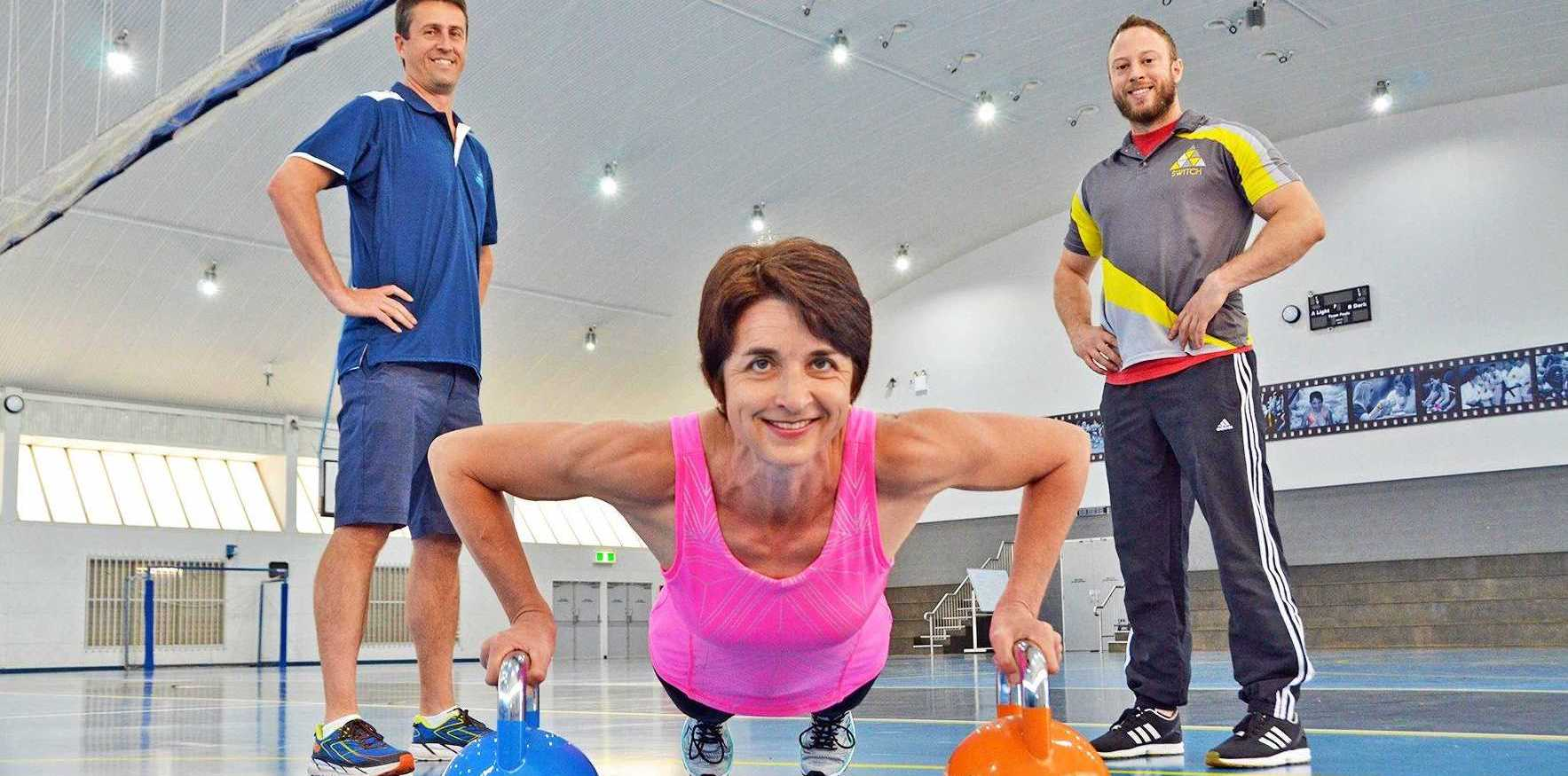 FIT: Gearing up for the 2017 Lismore Workers Masters Games fitness challenge were competitor Mari van Tonder with Lismore Workers Masters Games chairperson Matt Barlow and SWITCH gym trainer George Stevens.