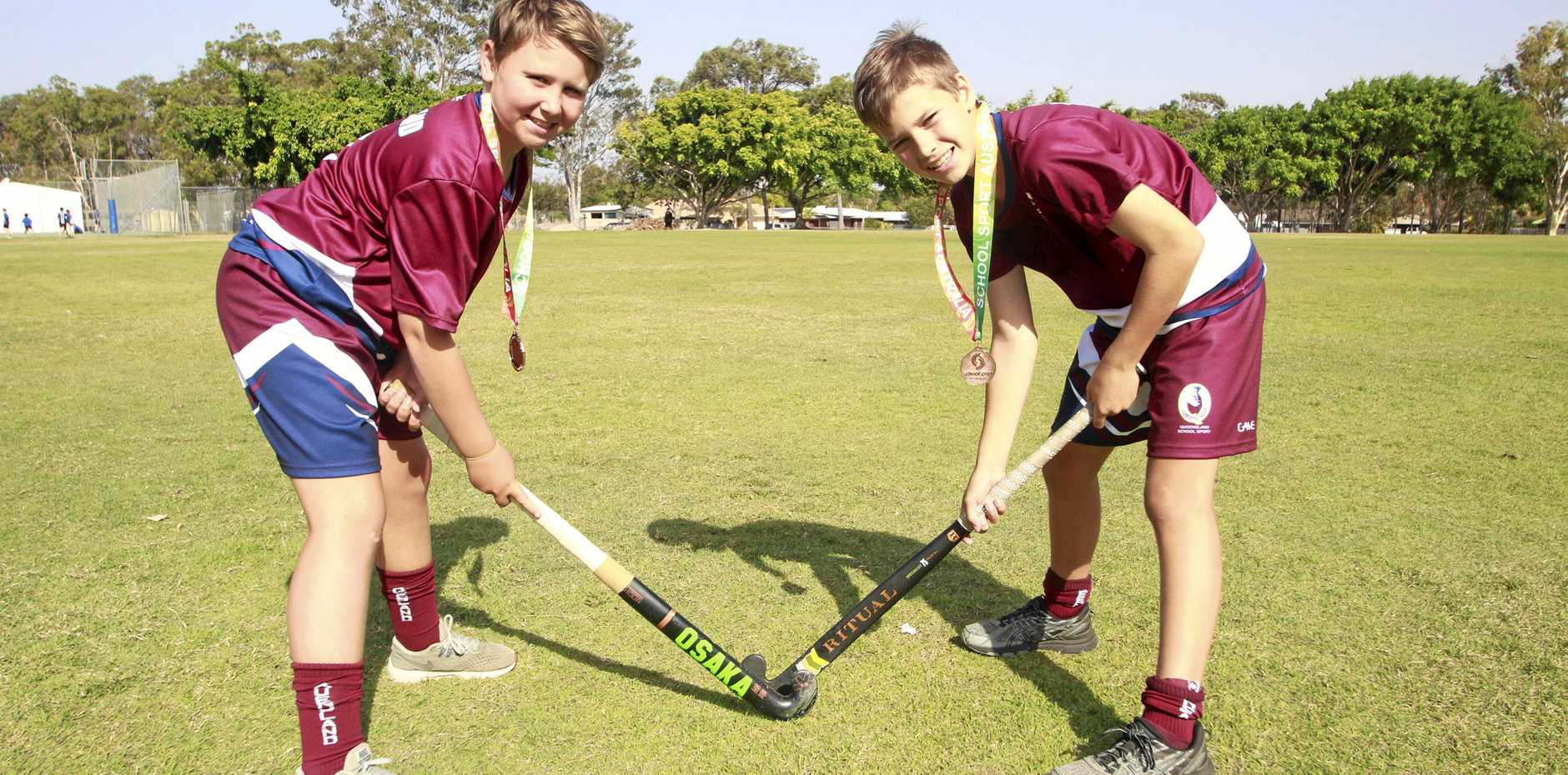 FUTURE KOOKABURRAS: Hockey stars Owen Taylor and Harley Woodall from Kawungan State School showing off their bronze medals.