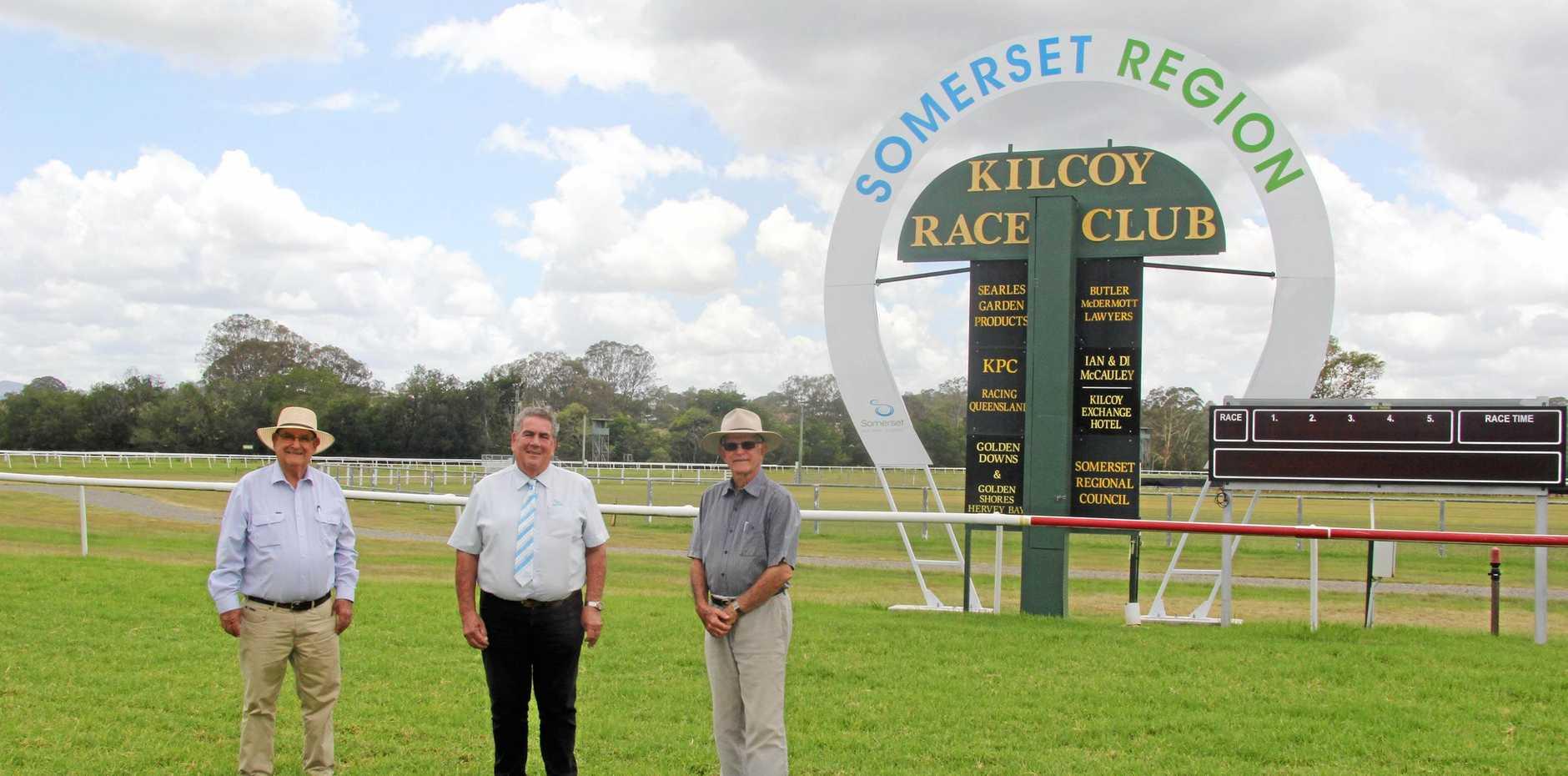 Kilcoy Race Club president Con Searle, Somerset Mayor Graeme Lehmann and Kilcoy Race Club vice-president Ian McCauley near the new Kilcoy Racecourse finish post.