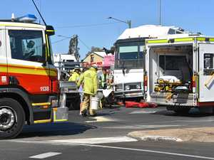 Driver left trapped in wrecked ute after colliding with bus