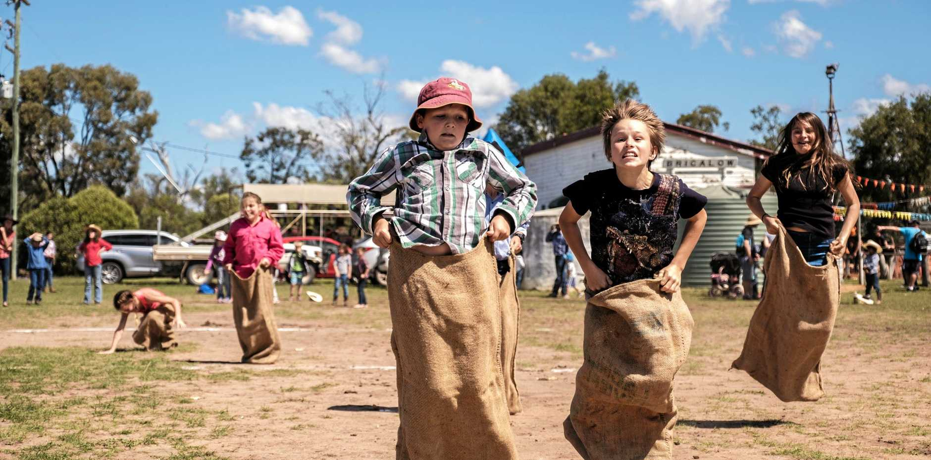 FAMILY FUN: Attendees have a fun time racing in the potato sack race at the Brigalow Bush Carnival.