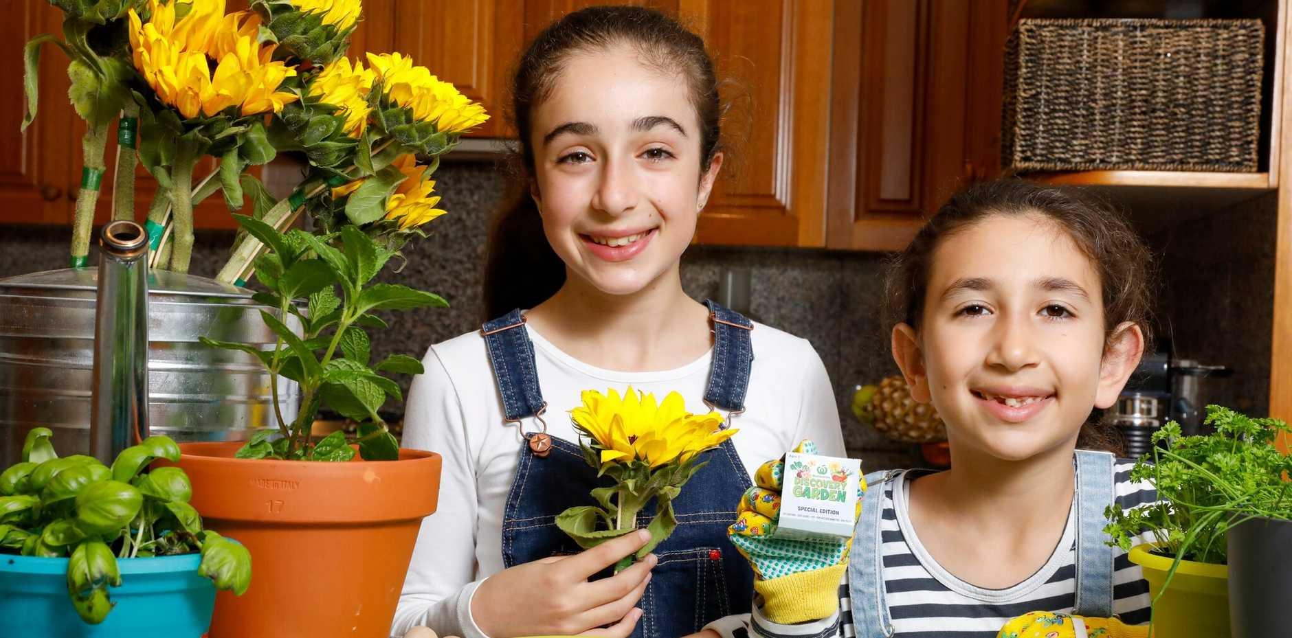 HELPING HAND: Ariel Qasabian, 10, and Abbey Qasabian, 8, with Woolworths' limited edition sunflower kits.
