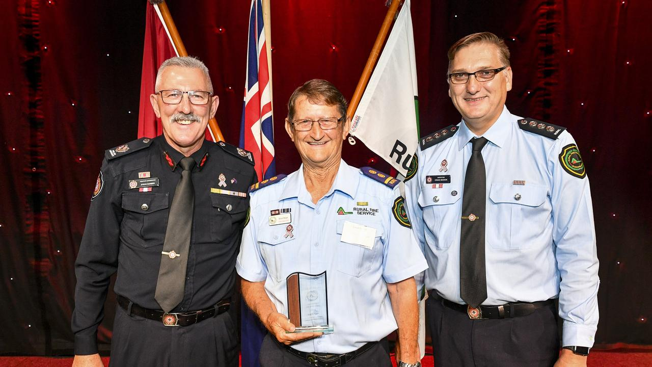 Assistant Commissioner Steve Barber, Volunteer of the year Errol Noye and Director for rural fire service in Gladstone, Craig Magick at the QFES volunteer conference.