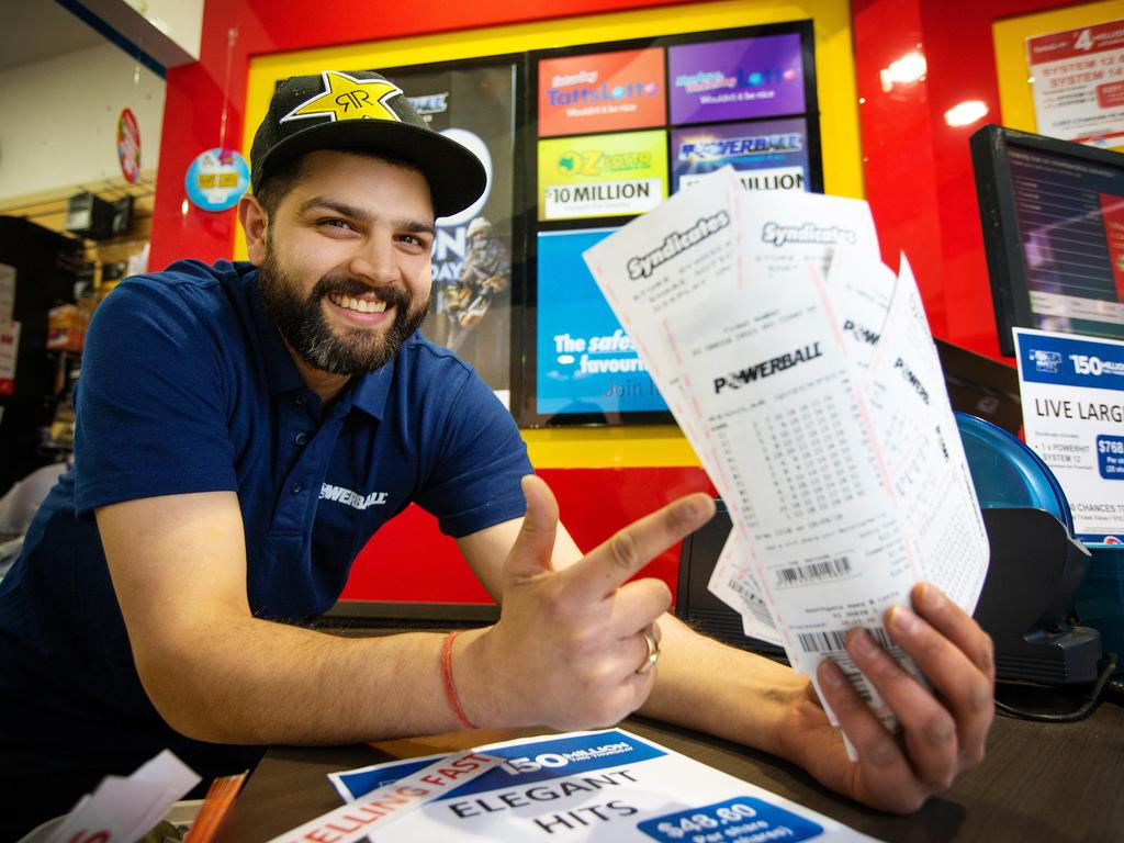 Neeraj Vic, from Southgate News and Lotto, is looking forward to the Powerball draw. Picture: Mark Stewart