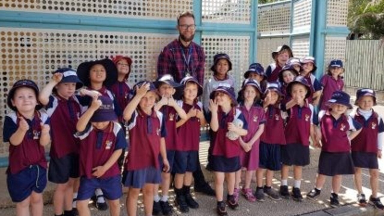Moranbah East State School's Adopt-a-Cop Constable Dale McIntrye with the school's preppies during their visit to the Moranbah Police Station.