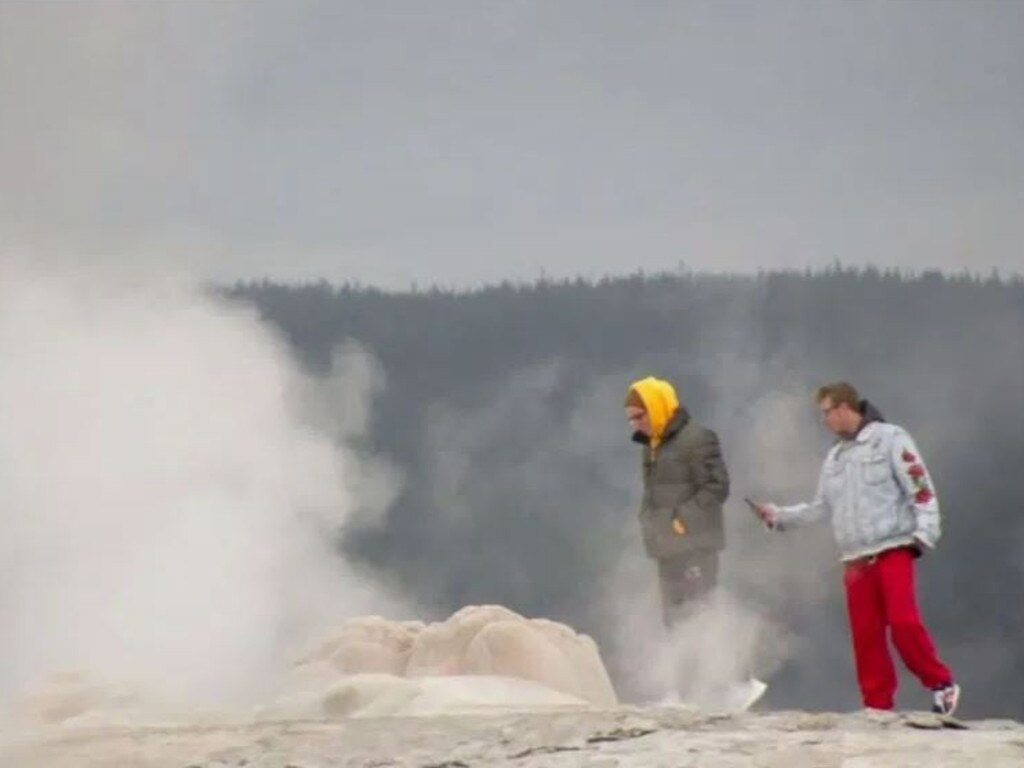 Two tourists have been arrested after getting too close to a geyser at Yellowstone National Park.