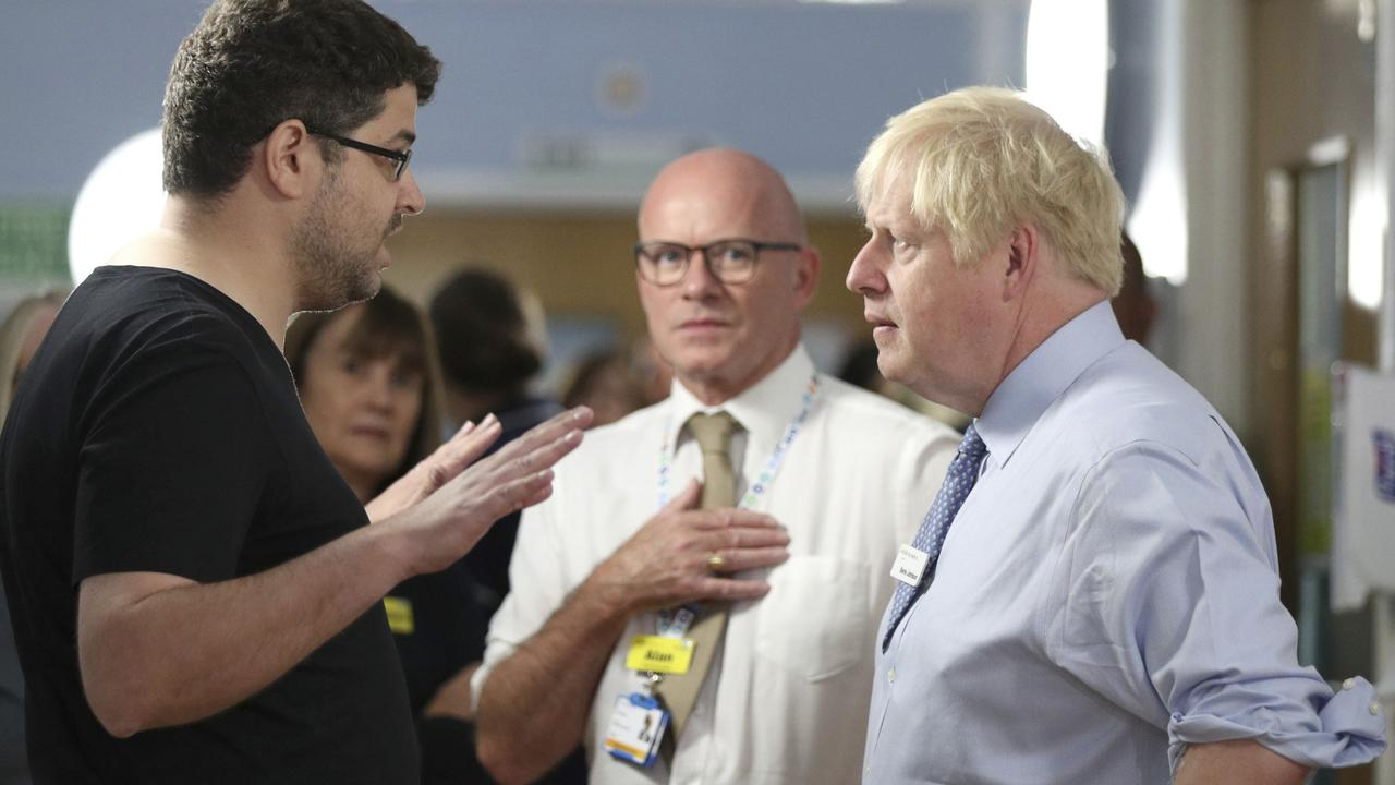 Omar Salem confronts British Prime Minister Boris Johnson. Picture: Yui Mok/WPA Pool/Getty Images