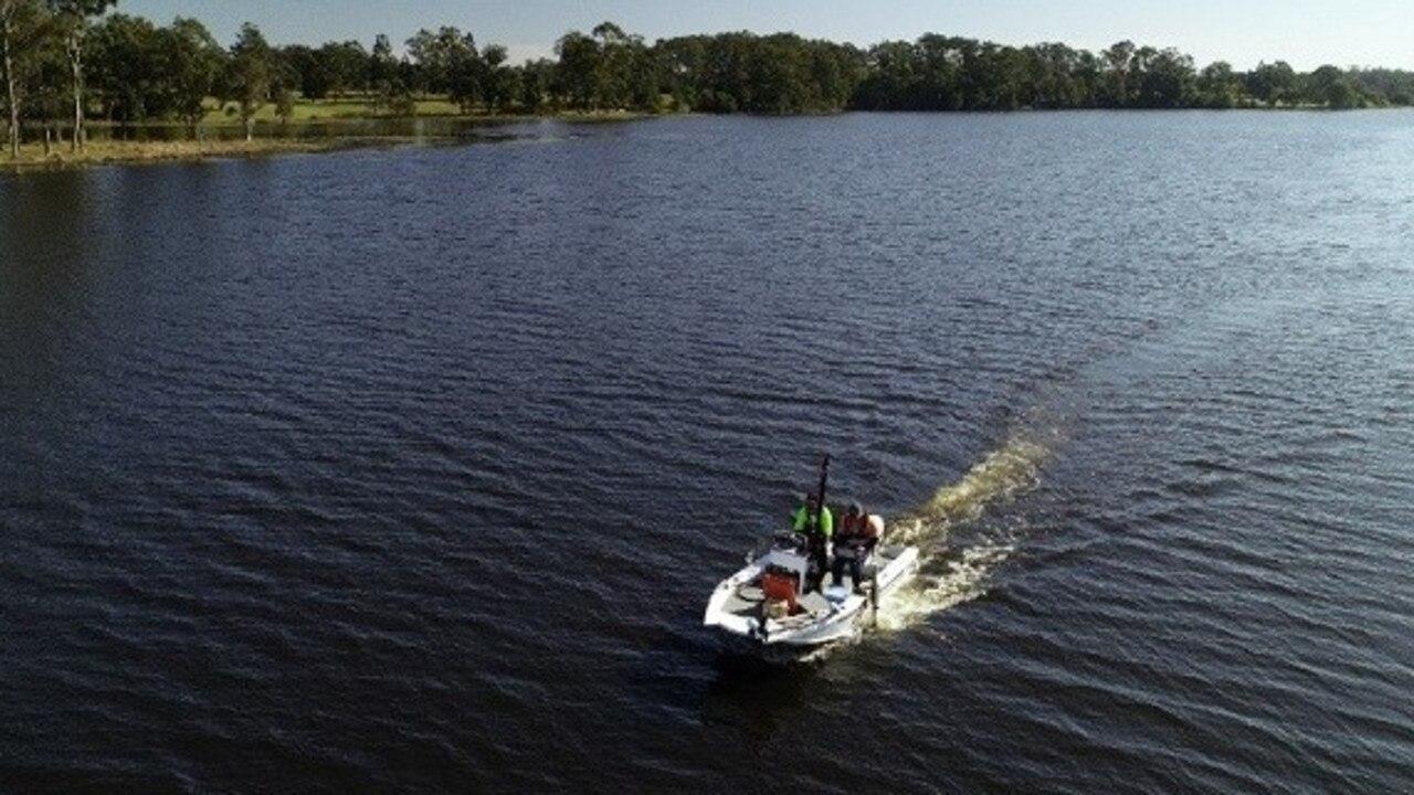 An Seqwater boat surveying fish life in Lake Macdonald.