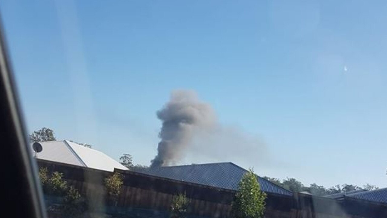 Smoke coming from the blaze at Brampton Court in Pimpama. Photo: Natallie Ward - Facebook