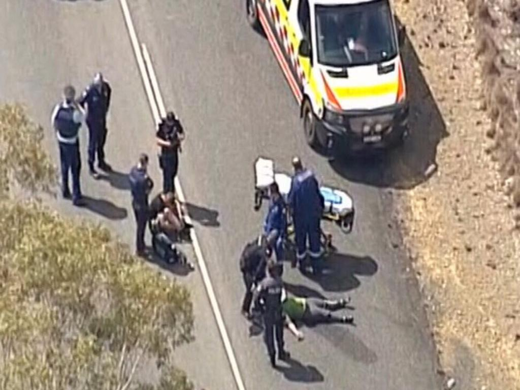 Police take a man and a woman into custody. Picture: 9 News