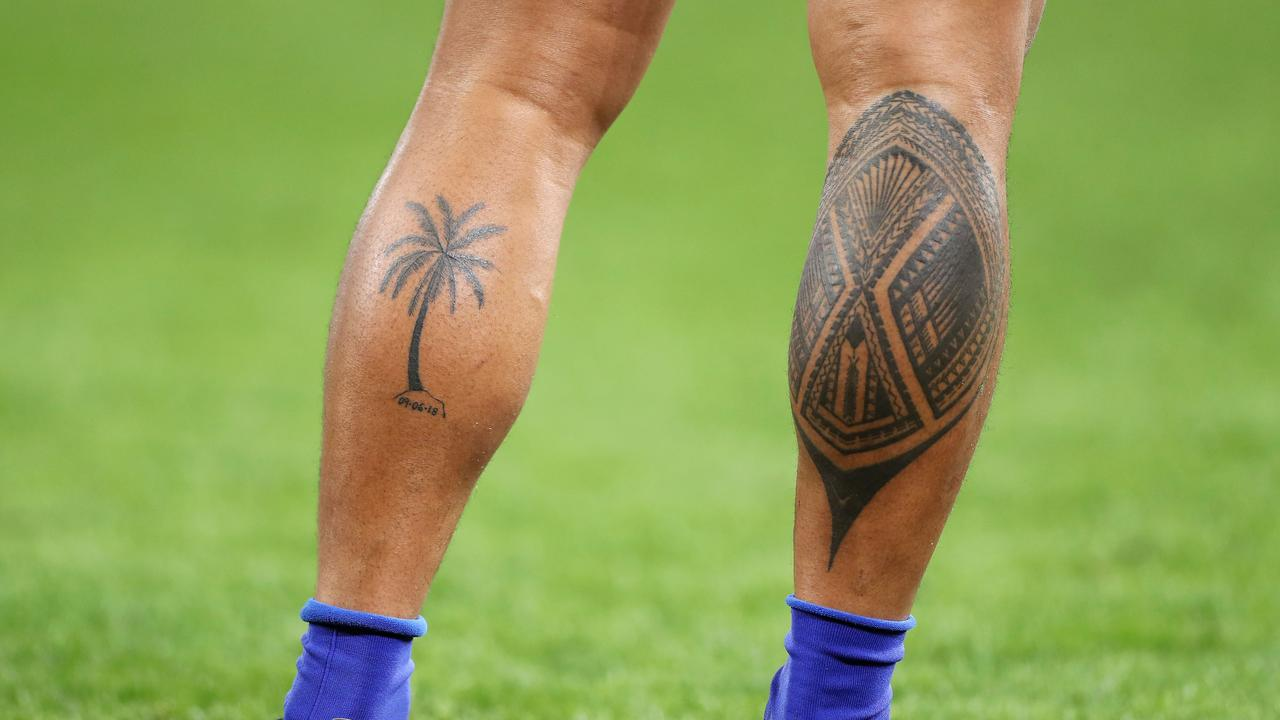 The tattooed legs of Ed Fidow of Samoa.