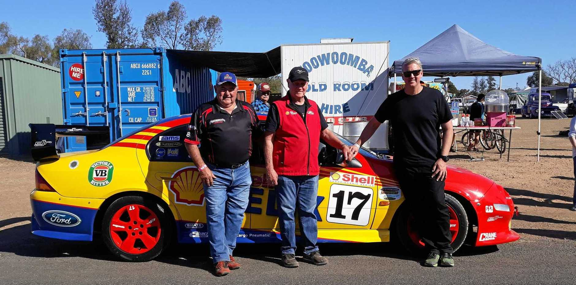 FAST CARS: Keith Edwards, of Withcott, with legend Dick Johnson and son Steve Johnson, in front of Keith's replica car.