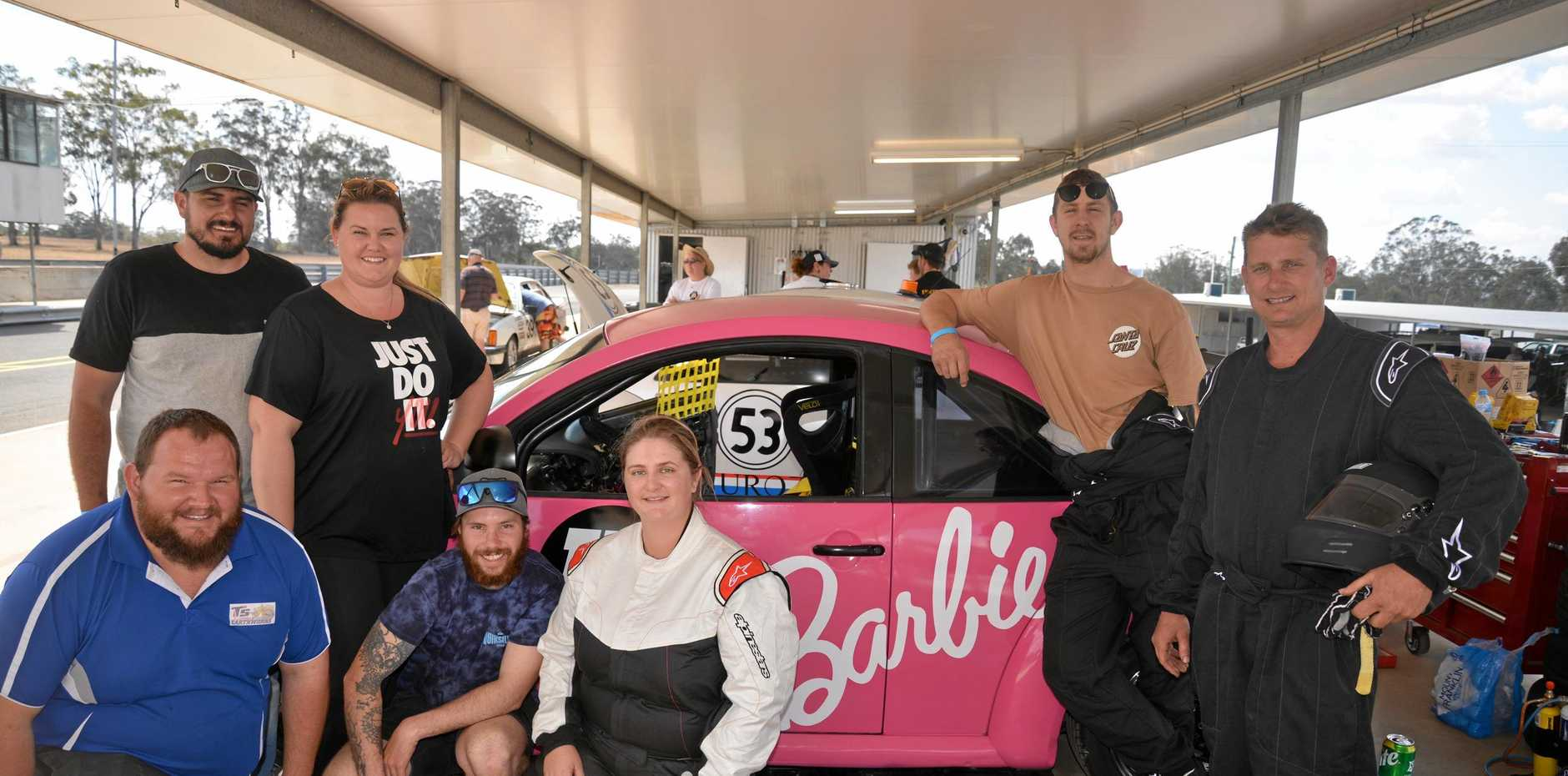 BARBIE TEAM: (Front) Taylor Sansby, Nick Nelson, Adrienne Doherty, (back) Brodee and Eva Gray, (right) John Mason and Tim Sewell are in their first 24 Hours of Lemons at Morgan Park which goes from 3pm Friday to 3pm Saturday.