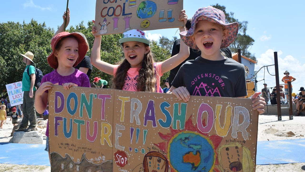 """(From left): Aisha Oliver, Zahara Jensen and Hopi Leggo chanted """"don't trash our planet"""" at the Sunshine Coast Schools Strike for Climate event at Cotton Tree."""