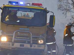 Bruce Highway bordered by flames in major blaze