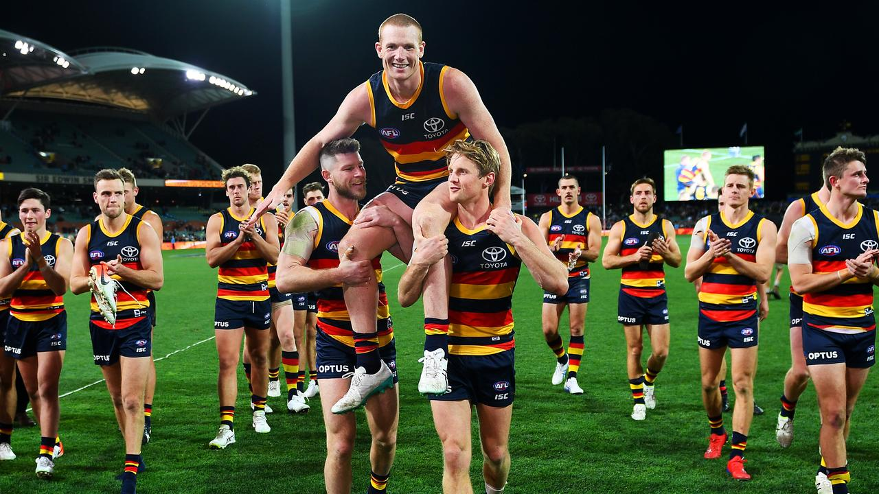 Adelaide Crows ruckman Sam Jacobs is chaired off by Bryce Gibbs and Rory Sloane for his 200th game at Adelaide Oval in Round 22. Picture: Mark Brake/Getty Images