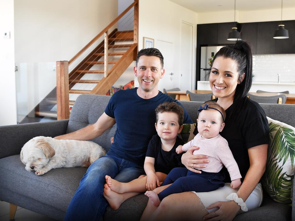 Glamorous former beautician Stacey Hollands is now CEO of her own organic cosmetics company Lust Mineral Cosmetics. Pictured with her husband James and her two children, Thomas, 3, and Sophia, 7 months. Photo Patrick Woods / Sunshine Coast Daily.