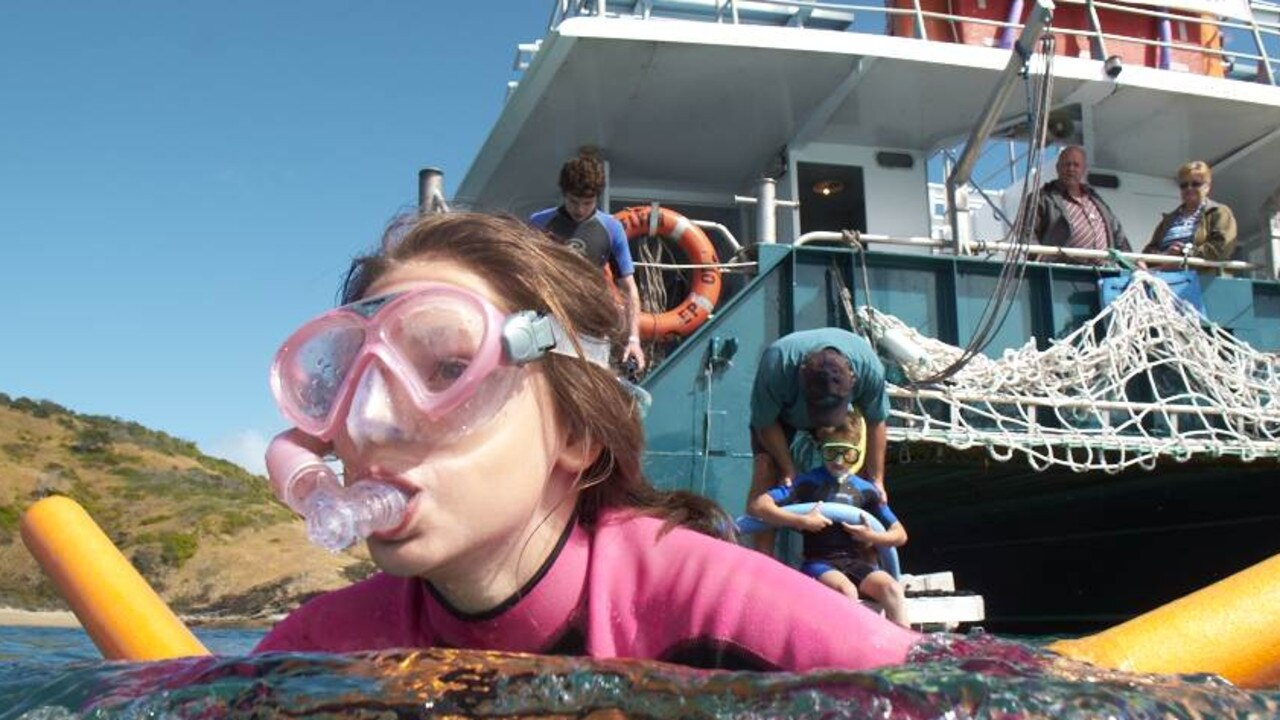 Go snorkelling off Great Keppel Island.