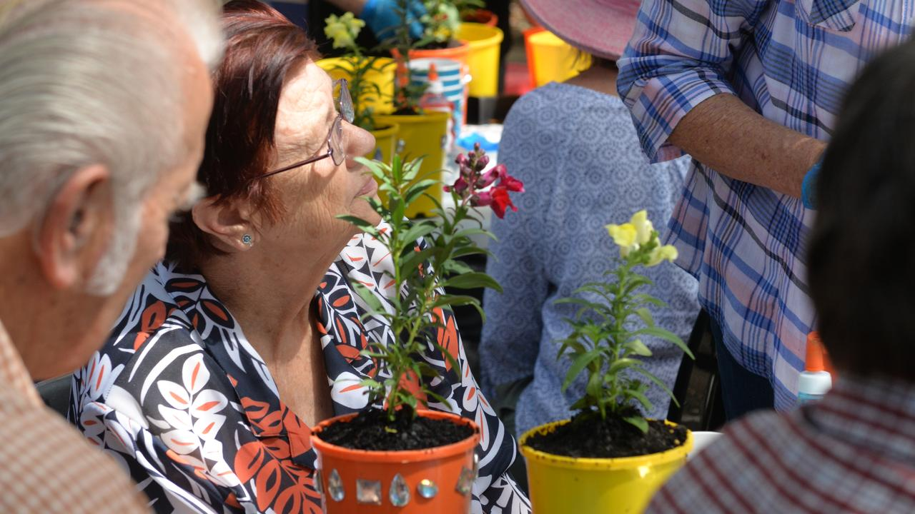 MAKING MEMORIES: An innovative project aimed at 'sustaining the memories' of people living with dementia while greening their homes was underway today in the Bundaberg Botanic Gardens.