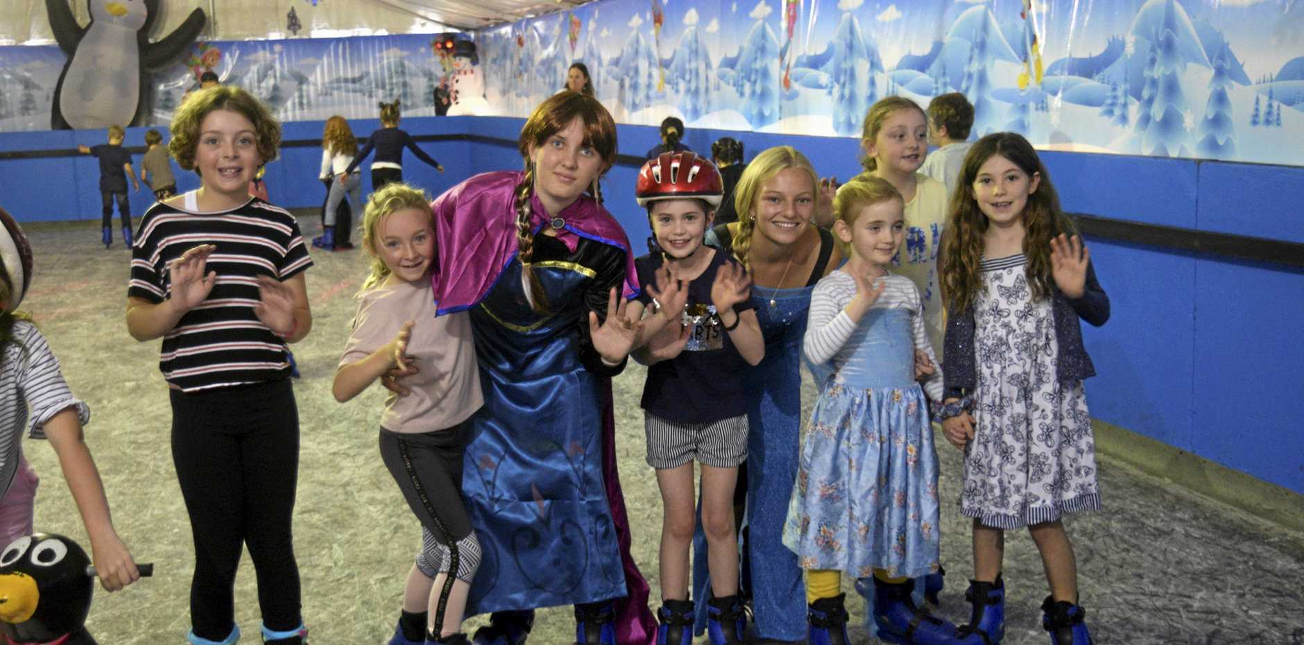 Elsa (Chelsea Bridges from Yamba Bowlo) and Anna (Molly McLeod from Yamba Bowlo) join the youngsters at the grand opening of the ice skating rink at the Bowlo Sports & Leisure centre on Saturday morning.