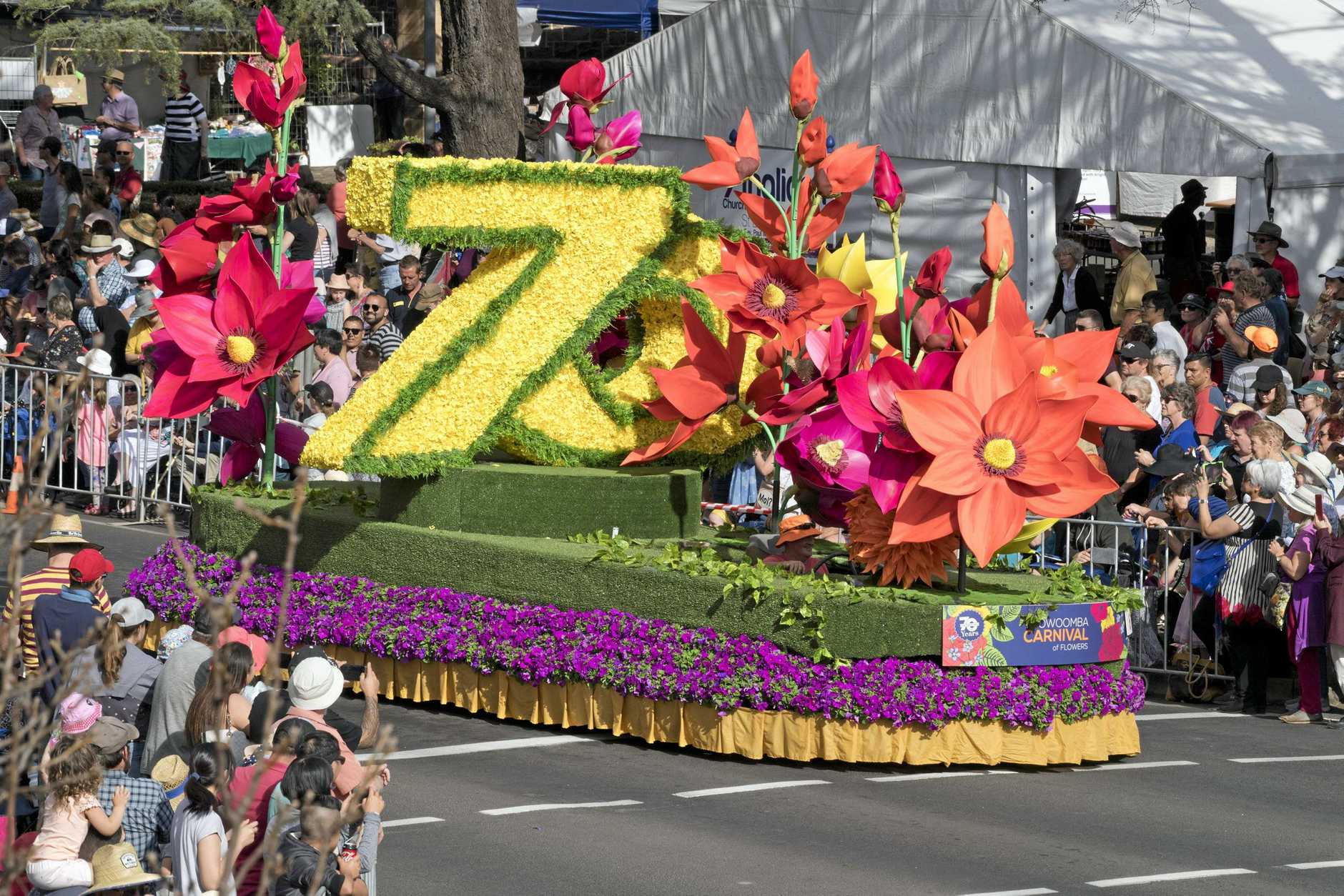 The parade celebrated the 70th year of the Carnival of Flowers.