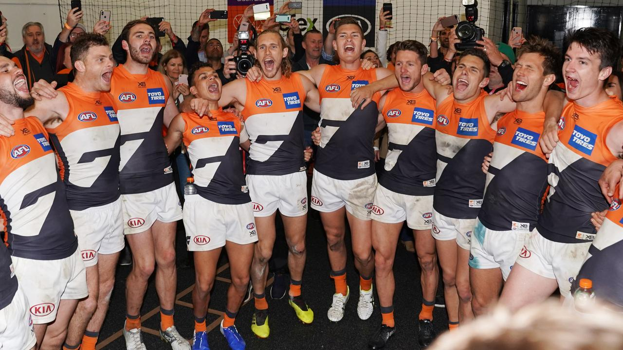 GWS players sing the club song after winning during the Second Preliminary Final match between the Collingwood Magpies and the GWS Giants during in Week 3 of the AFL Finals Series at the MCG in Melbourne, Saturday, September 21, 2019. (AAP Image/Michael Dodge) NO ARCHIVING, EDITORIAL USE ONLY