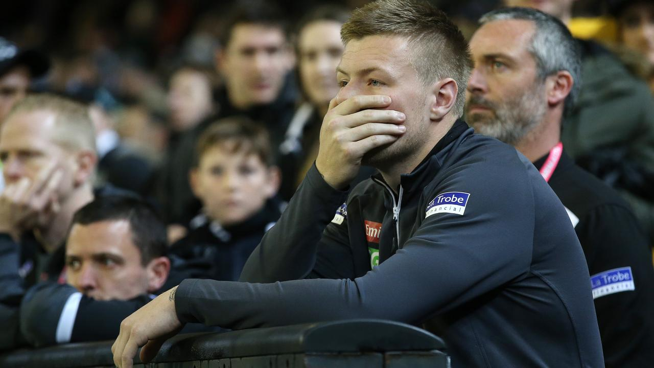 Injured Magpie Jordan De Goey watches from the sidelines. Picture: Michael Klein
