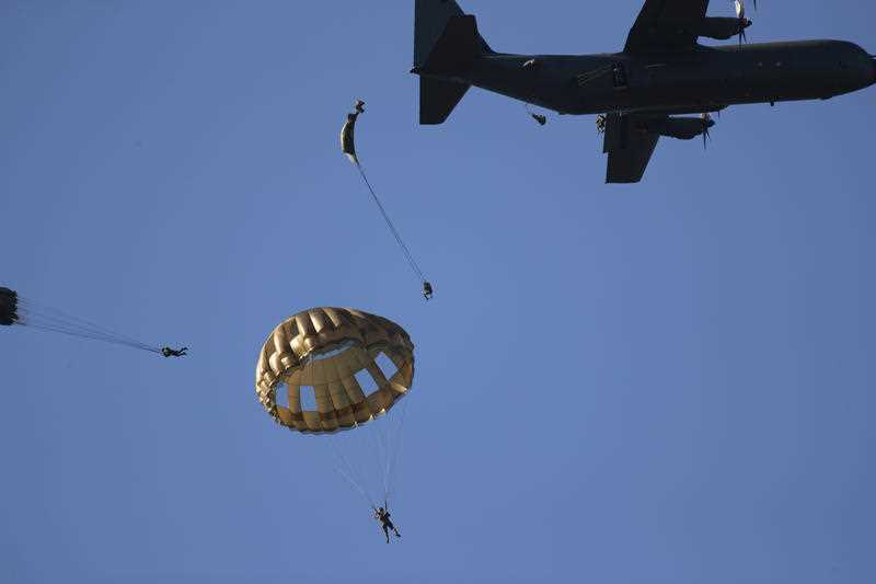 Parachutist jump from a Hercules plane at Ginkel Heath, eastern Netherlands, Saturday, Sept. 21, 2019, as part of commemorations marking the 75th anniversary of Operation Market Garden