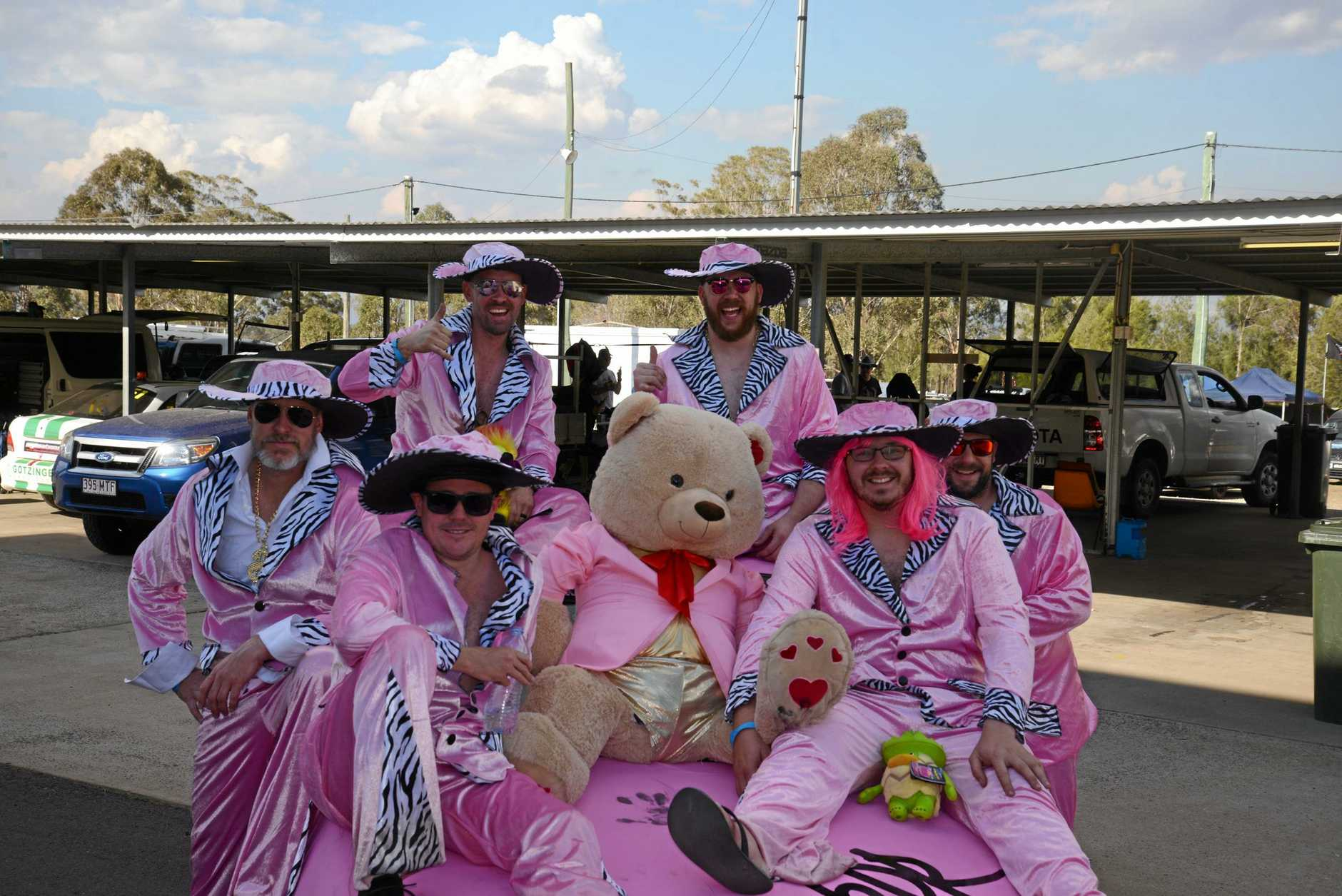 (Front, from left) Brisbane Lemons team Kris Martin, Grant Hanrick, (back) Greg Fairbrother, Dave McNallis, James Cuskelly and Nick May after finishing 24 Hours of Lemons in their pink car