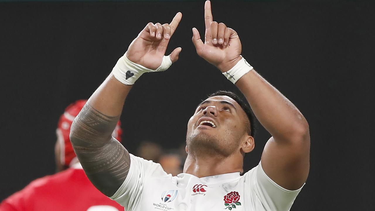 England's Manu Tuilagi reacts after scoring a try.