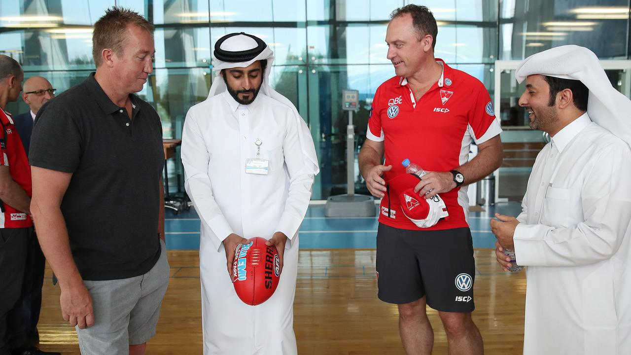 Robinson and Swans coach John Longmire at a sports medical facility in Qatar.