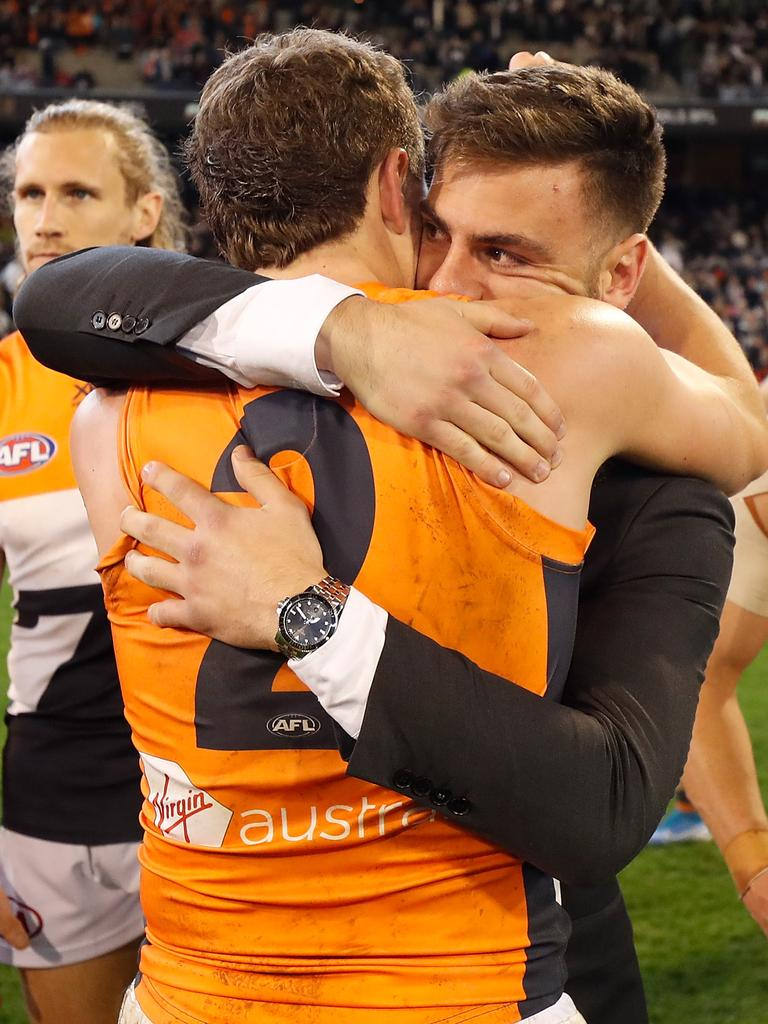 Stephen Coniglio embraces teammate Jacob Hopper after the preliminary final. Picture: Michael Willson/AFL Photos via Getty Images.