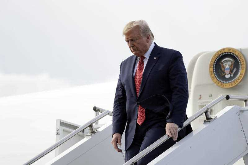 President Donald Trump arrives at Lima Allen Airport to participate in a tour of Pratt Industries with Australian Prime Minister Scott Morrison, Sunday, Sept 22, 2019, in Lima, Ohio.