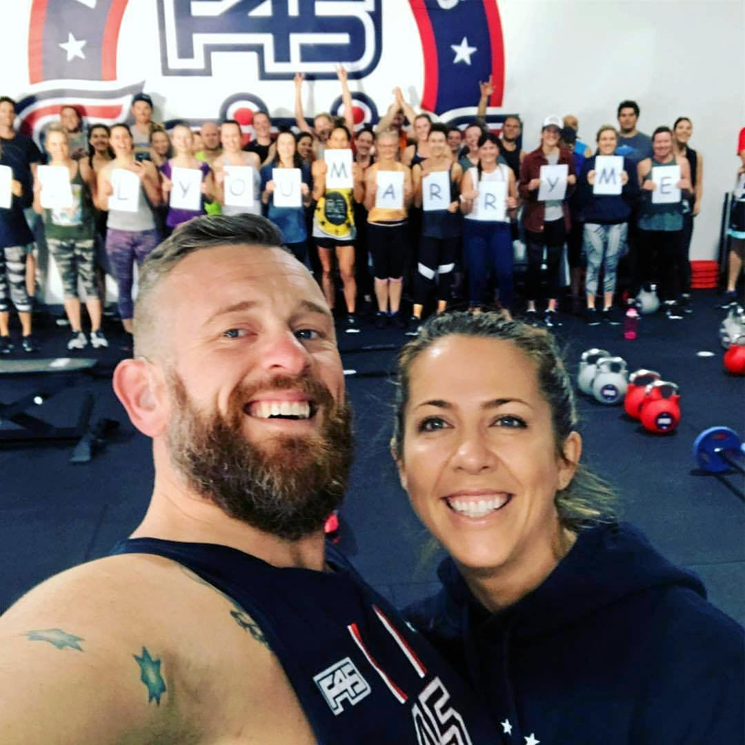 HAPPIER TIMES: Scott Shoesmith and his wife, Liz, along with members from his gym.