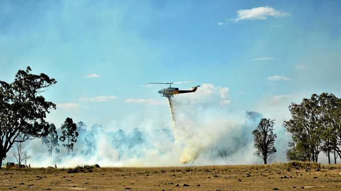 GALLERY: Firefighters, helicopters battle to save homes