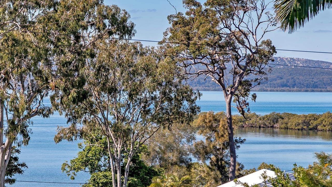 The view across Cow Bay to North Stradbroke Island from the front balcony of 151 Kate St, Macleay Island which is for sale for $389,000.