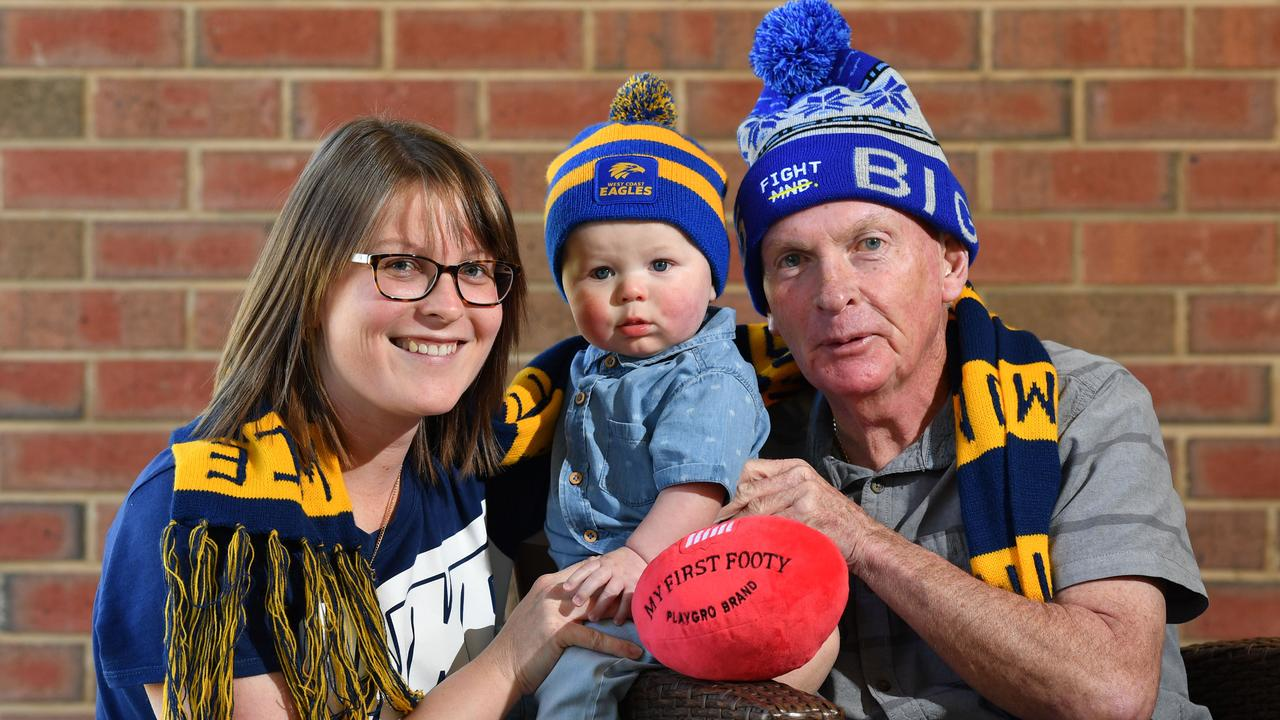 Graham Johnson with his daughter Rebecca Leach and grandson Hunter. Image: AAP/Keryn Stevens