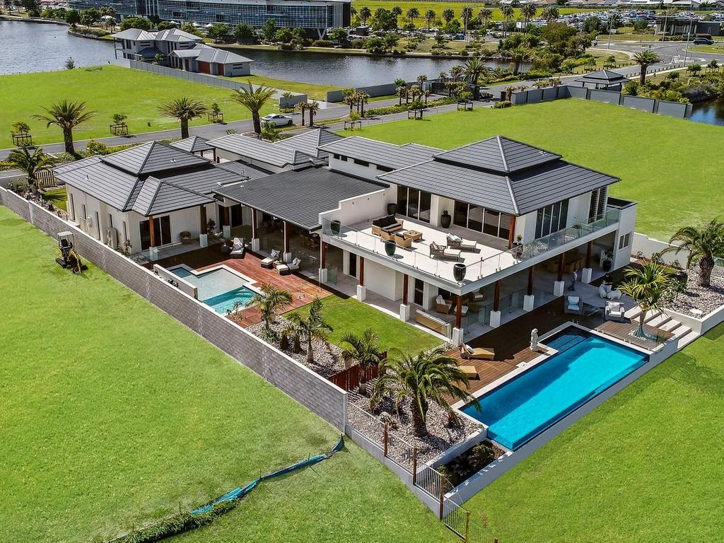 The five-bedroom, five-bathroom home at 5 Entrance Island, Bokarina, which backs onto Lake Kawana, was built in 2017 by its current owners.