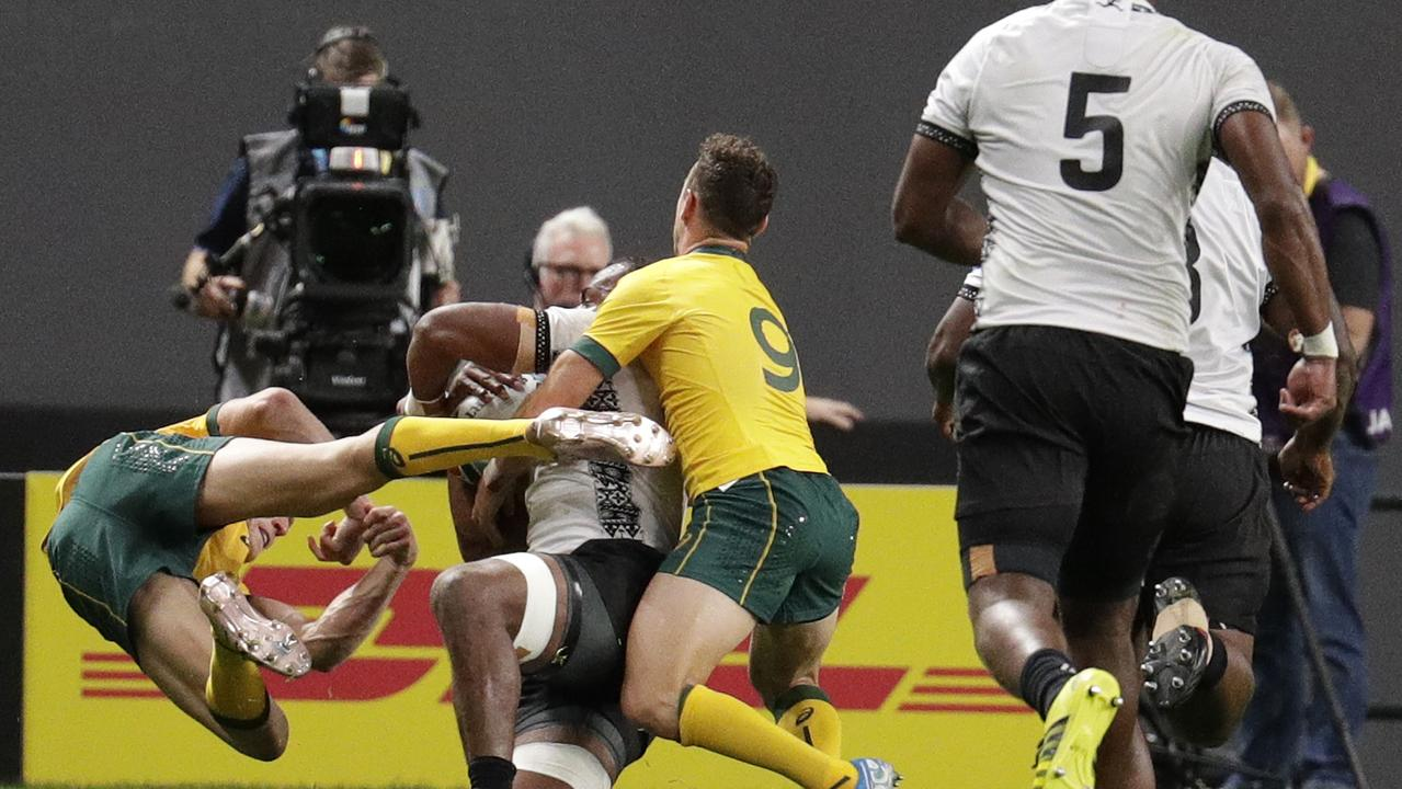 Australia's Reece Hodge, left, flies as he is pushed away by Fiji's Peceli Yato. Hodge has been cited over the contact. Picture: AP
