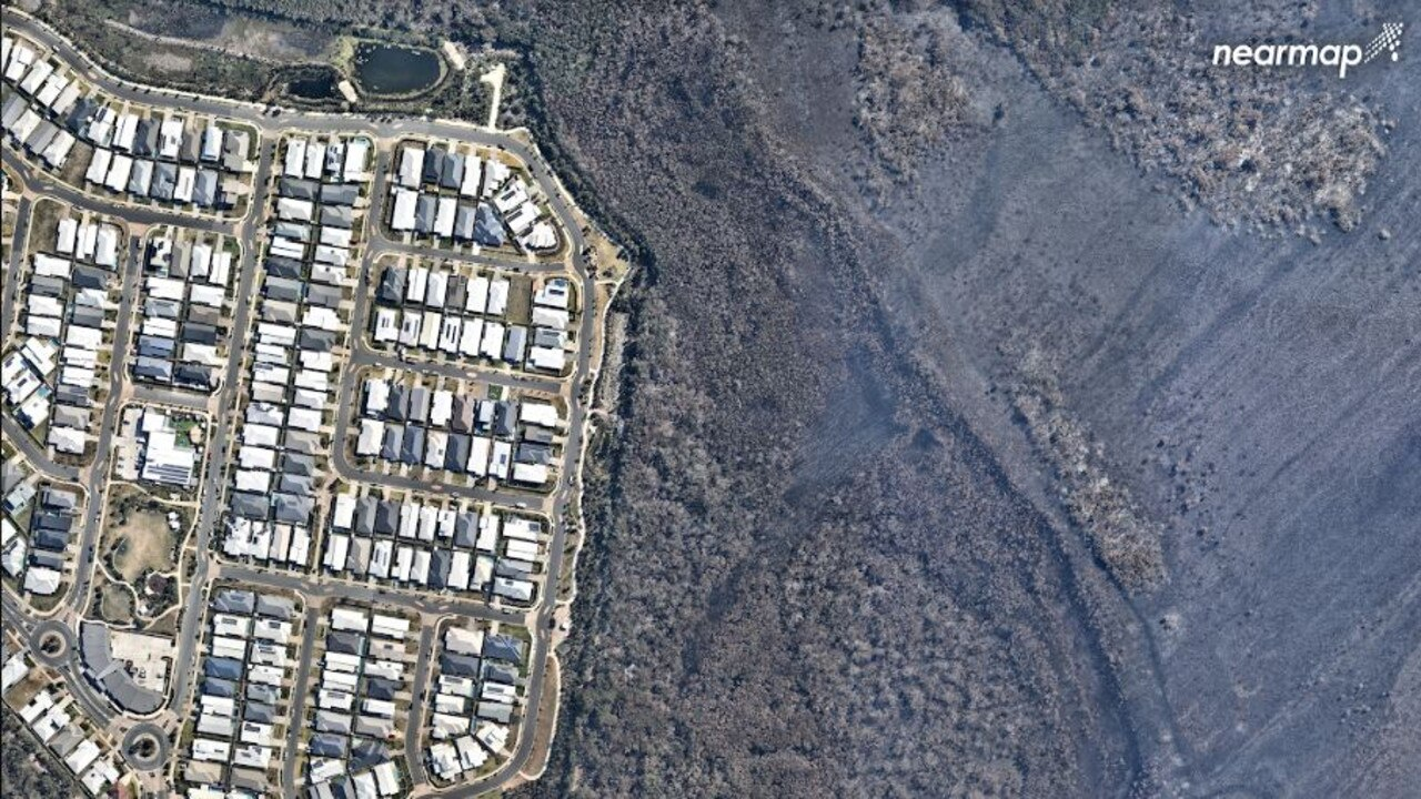 This September 16 photograph again shows how close the bushfire came to destroying homes before being turned away by desperate fire fighters.