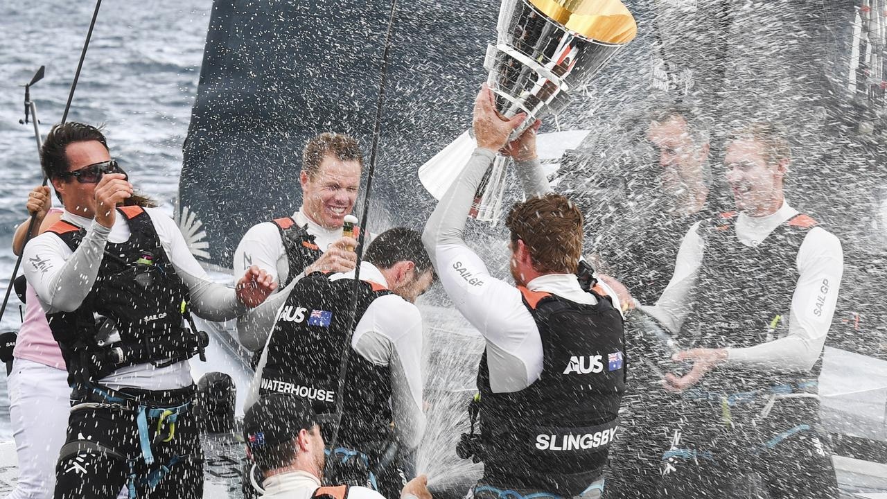 Sam Newton, second from left, and crewmates celebrate after winning the SailGP title.